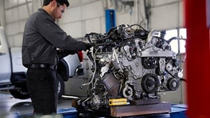 ACDelco Engine Components Tile - Technician Working on Engine