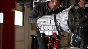 ACDelco Transmission & Transfer Cases Tile - Technician Working on Transmission